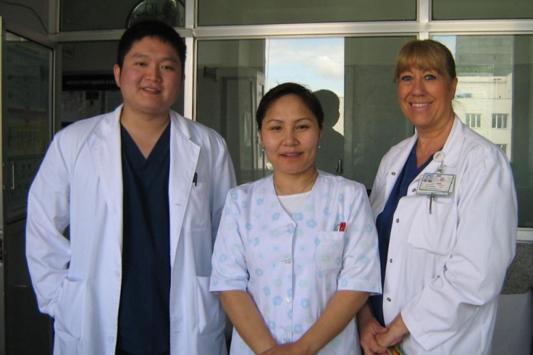 A health intern on a volunteer project abroad poses with two healthcare professionals in Mongolia.